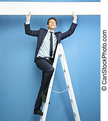 Joyful businessman setting the advert - Joyful businessman...