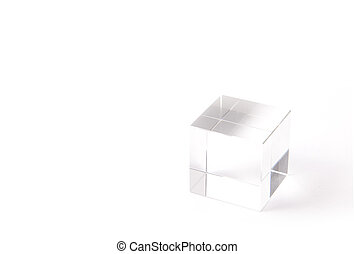 paperweight of a transparent cube - This is a paperweight of...
