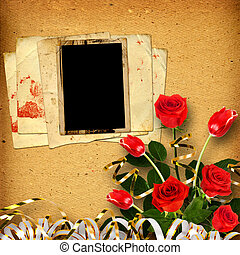 Old vintage album for photos with a bouquet of red roses and...