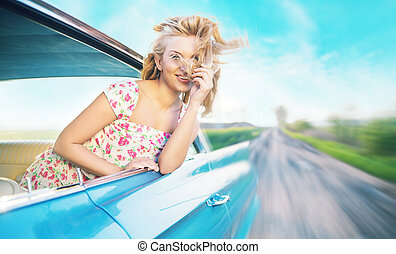 Blond lady during the fast ride - Blond woman during the...