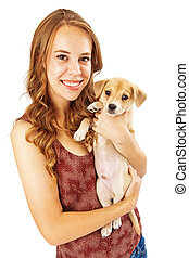 Pretty Teenage Girl Holding Puppy - A pretty young female...