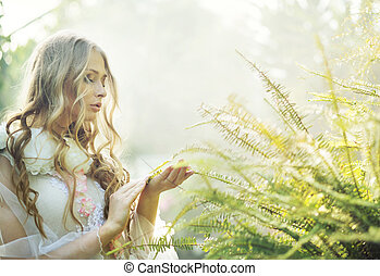 Pretty blonde woman with the fern