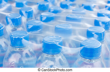 bottled water bottles in plastic wrap - Rows of water...
