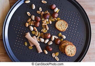 nuts baguette sticks rasin on black - peanut hazelnut...
