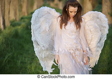 Alone angel walking in the forest - Alone angel walking in...