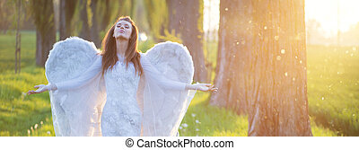 Relaxed woman with the huge wings