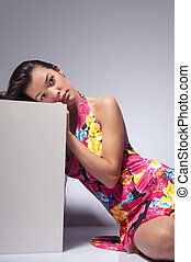 beautiful woman on the grey background - young woman rests...