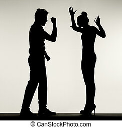 Silhouette of arguing couple - Silhouette of the arguing...