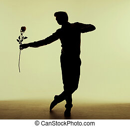 Tall man dancing with the rose
