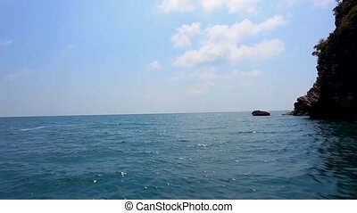Sailing of speed boat next to a rock islands. Footage