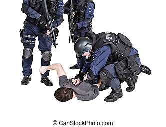 Detention - Special weapons and tactics SWAT team makes a...