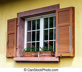 Renovated pvc windows in old village house, Alsace, France