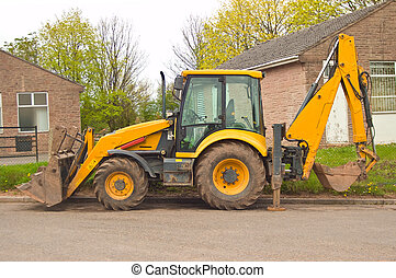 Parked JCB - a parked jcb earth mover with stabalising legs...