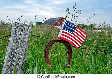 Country Colors - Rusty old horseshoe and flag on a barb wire...