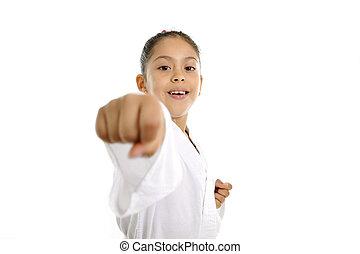 sweet latin little girl in karate martial arts practice...