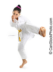 sweet latin little girl stretching leg in martial arts...