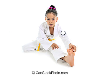 sweet latin little girl stretching leg in karate practice -...