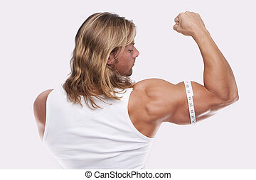 Athletic sexy male body builder with the blonde long hair. gladi