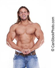 Athletic sexy male body builder with the blonde long hair...