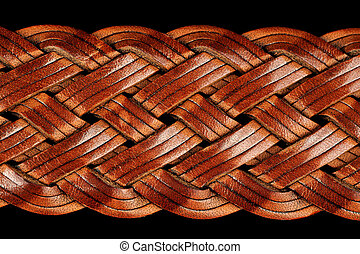 Braided Leather Belt Close-Up - A close-up shot of brown...