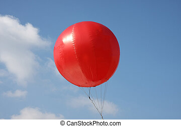 Red balloon high in the sky in Belgrade,Serbia