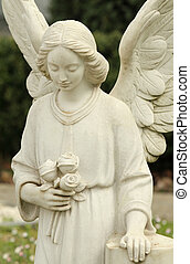 closeup of cemetery angel statue holding roses, Bologna,...