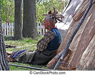Resting Brave - Indian resting by his tepee.