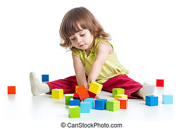 smiling kid girl playing building block toys