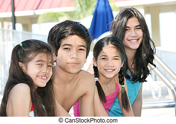 Four children by the pool side - Four children enjoying the...