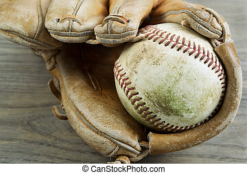 Old Baseball and Glove on Faded Wood