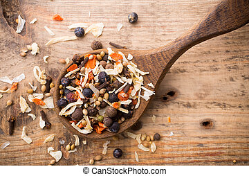 Spice. - Spice mix a wooden spoon on a wooden background.