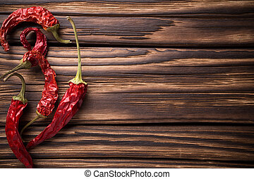 Spice. - Red chili peppers on a wooden background. The menu...