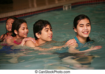 Four children swimming together