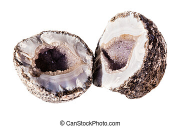 Open geode - an open amethyst geode isolated over a white...