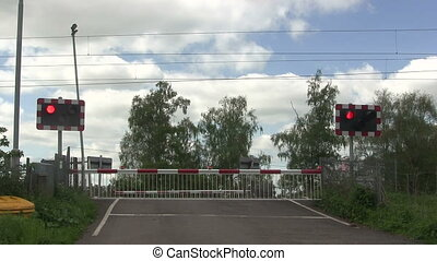 Diesel train crossing a level crossing video showing the red...