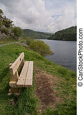 Wooden Bench overlooking a Lake