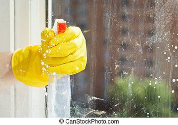 cleaning window glass from spray bottle - cleaning window...