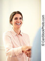 Adult charming businesswoman giving hands greeting