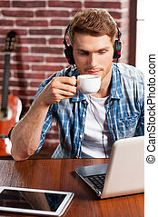 Music is my life Top view of handsome young man in...