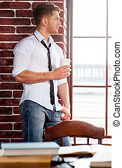 Refreshing his mind. Handsome young man in shirt and tie...