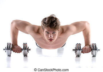 Sport Man - Young smiling fitness man doing push ups on...