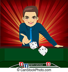 Man Playing Craps - Handsome young man playing craps...