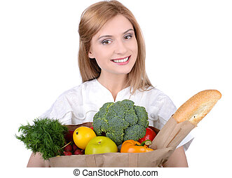Shopping - Young woman holding a shopping bag full of...