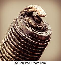 Auto service. Old spark plug as spare part of car. - Auto...