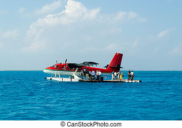Seaplane in Maldives - Red hydroplane at the dock station in...