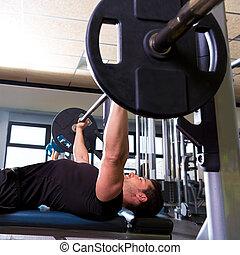 Bench press weightlifting man at gym - Bench press...