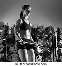 Barbell woman workout fitness in weightlifting gym