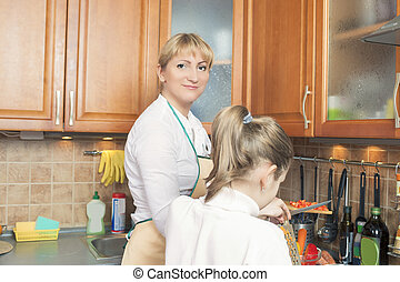 Mother and Her Daughter Together Preparing  Food