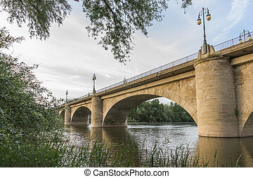 Stone Bridge or San Juan Ortega Bridge over the Ebro River,...