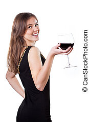 Beautiful girl holding a glass of red wine